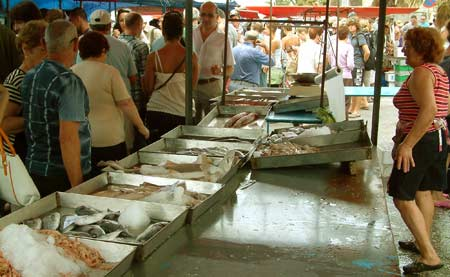 Fish stall at a busy Sunday morning market in Marsaxlokk, south Malta