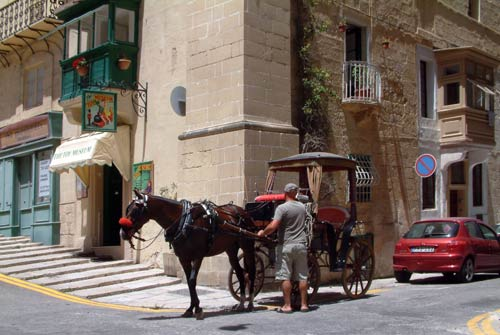 Horse and cart cabs or taxis for sightseeing or getting around Valletta