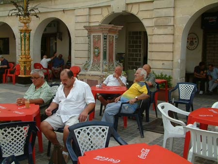 Men drinking outside a pub in RabatMalta