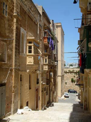 Narrow street in Valletta with typical balconies