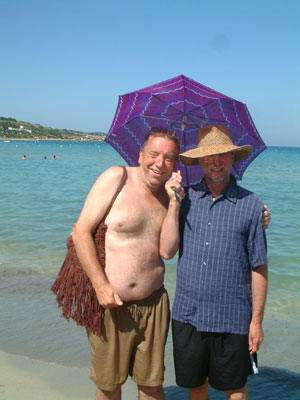 Weather and climate in Malta, you might look like a twerp but a hat and umbrella will help prevent sun stroke and sunburn